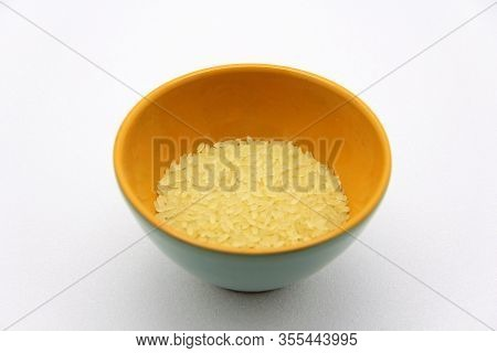 Ceramic Bowlwith Rice On A White Background, Top View. The Concept Of Healthy Nutrition, Diets, Vege