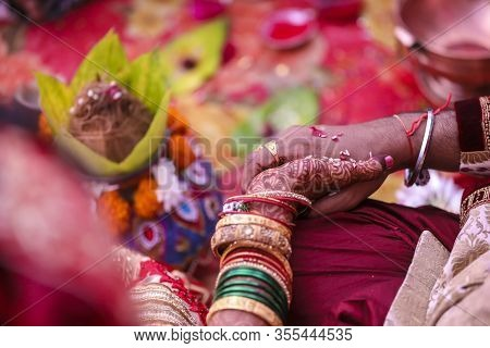 Indian Traditional Wedding: Groom And Bride Hand
