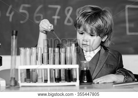 Little Boy At Lesson. Back To School. Biology Science. Science Experiments In Lab. Little Boy Is Mak
