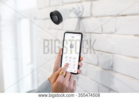 Controlling Video Surveillance And Home Alarm With Mobile Application, Close-up On A Smart Phone Wit