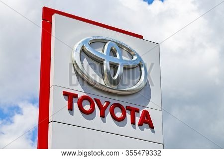 Toyota Shield Of A Car Dealership In Front Of Gray Sky