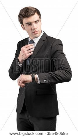 Isolated Portrait Of Confident Young European Businessman In Elegant Suit Checking His Wristwatch An