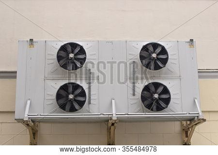 Air Conditioning On A House Wall. Industrial Air Conditioning On The Back Of The Store. Air Conditio