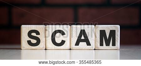 Scam Concept Using Wooden Block, Business Concept.