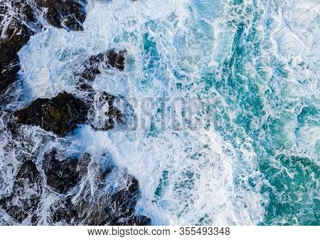 Drone Aerial View Of Waves Crashing Over Rocks On Lumahai Beach On North Shore Of Kauai