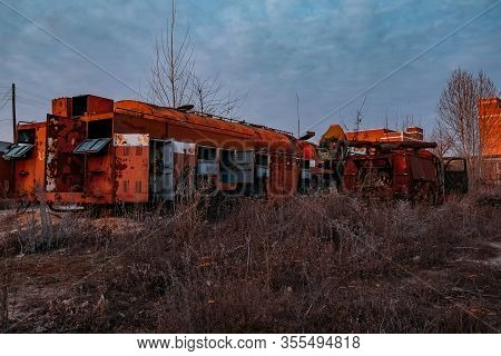 Old Rusty Broken Abandoned Soviet Fire Truck On Evening Sunset