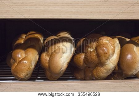Fresh Wicker Buns On A Bakery Counter