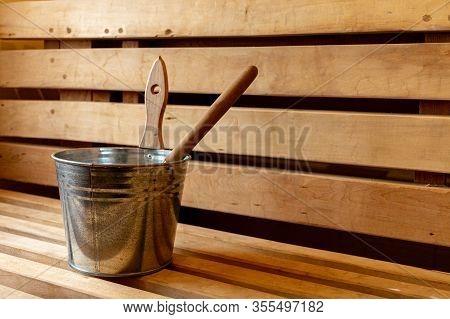 Sauna Accessories In Wooden Sauna. Relaxation In The Sauna