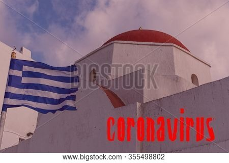Greece Covid-19 World Outbreak Concept. Greek Flag Waving Before An Island Orthodox Church And Coron