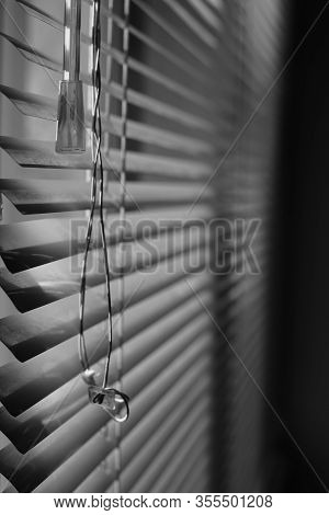 Horizontal Metal Jalousie With Old Rope. Bw