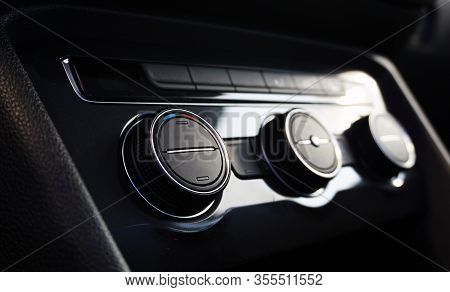 Air Conditioning Control Knobs Of A Luxury Modern Car. The Central Control Knob Is In Focus, The Oth
