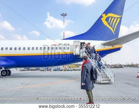 Krakow, Poland - March 13, 2020 Passengers Get Out Of The Aircraft Ryanair, Cancellation  All Flight