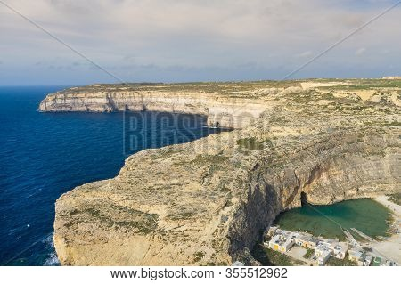 Dwejra Is A Lagoon Of Seawater On The Island Of Gozo. Aerial View Of Sea Tunnel Near Azure Window. M