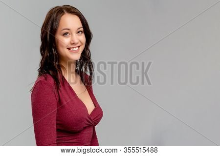 Happy That Everything Is Okay. Portrait Of Charming Friendly Caucasian Girl Smiling Cheerfully While