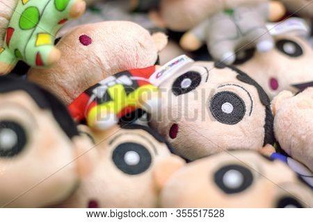 Taipei, Taiwan - January 08, 2020: Crayon Shin Chan Anime Character Plush Doll In A Crane Catcher Ma