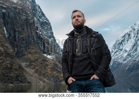 Man near Naeroyfjord in Gudvangen village, Norway