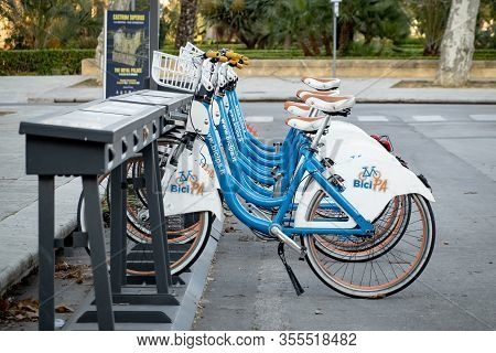 Palermo, Sicily - February 8, 2020: Bike-sharing In Palermo. Rental Bikes Of The Bicipa Company Left