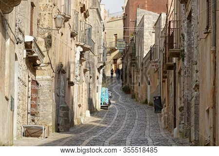 Erice, Sicily - February 2019: Via Vittorio Emanuele Street In Ancient Erice City With A Road Made F
