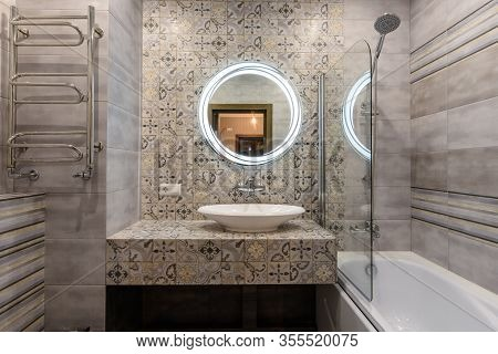 The Washstand And Bathroom In The Interior Of A Small And Modern Bathroom