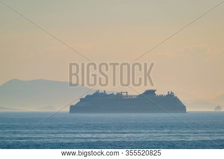 AEGEAM SEA, GREECE - MAY 30, 2019: Cruise liner ship Edge of Celebrity lines in Mediterranea sea. Aegean sea, Greece