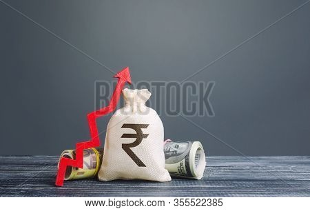 Indian Rupee Money Bag And Red Arrow Up. Influx Of Investment And Capital, Increase Of Wealth. Risin
