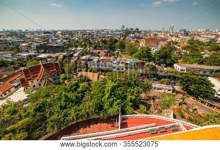Traditional Thai Architecture With Modern Buildings. Cityscape Of Bangkok, Thailand As Seen From Tem