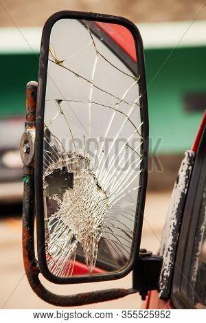 Cracked Side Mirror On An Old Truck. Broken Truck Mirror