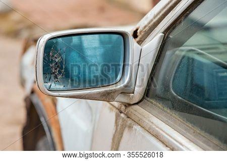 Car With Broken Side Door Mirror. Broken Car Mirror. Cracks In The Left Rearview Mirror