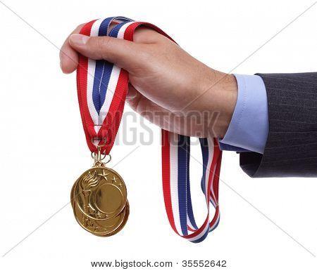 Business success businessman holding gold medals