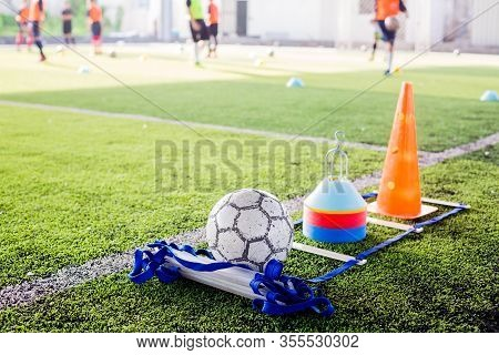 Soccer Ball And Marker Cone With Training Equipment On Green Artificial Turf
