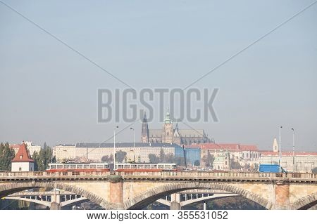 Panorama Of The Old Town Of Prague, Czech Republic, With A Focus On Palackevo Most Bridge With A Tra