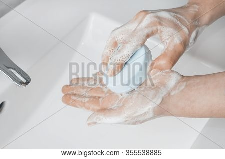 Hand Washing Techniques: Woman Soaping Her Hands With A Bar Of Soap.