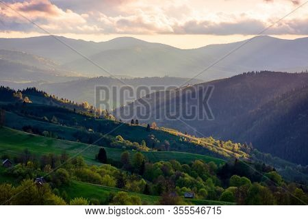 Mountainous Rural Area. Agricultural Fields On Hills With Forest. Beautiful And Vivid Countryside La