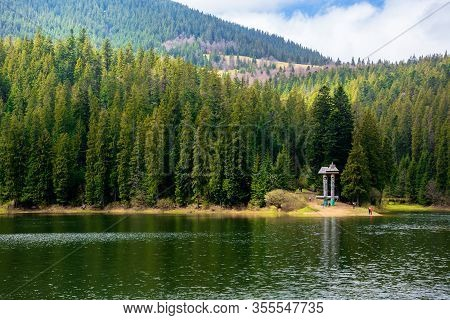 Alpine Mountain Lake Among The Forest. Beautiful Sunny Weather With Fluffy Clouds On The Blue Sky. S