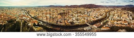 Aerial Panorama View From Graz Hill Schlossberg In Austria, Cityscape With House Roofs, Mur River An