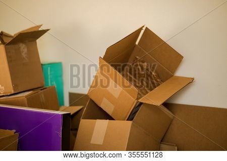 Stacks Of Boxes Used In Shipping Items From Online Commerce.