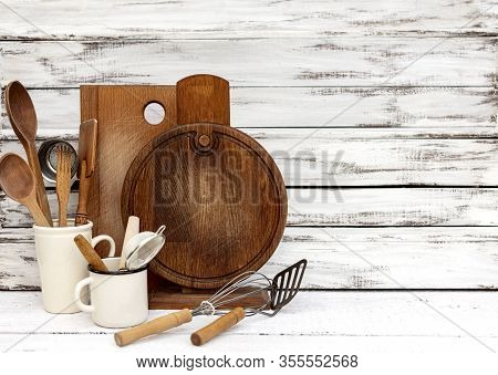 Vintage Old Baking Utensils On A White Wooden Background. Selective Focus.
