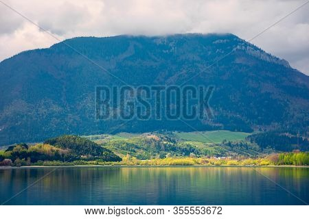 Lake In Mountains. Cloudy Day In Springtime. Beautiful Scenery Of High Fatra Mountains In Dappled Li