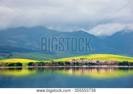 Lake In Mountains. Cloudy Day In Springtime. Rural Fields On Rolling Hills. Beautiful Scenery Of Hig
