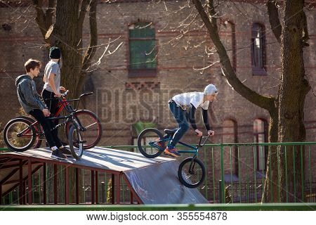 Lviv, Ukraine - March 12, 2020: Bmx In The City Skatepark. A Group Of Teens On Bmx Bikes In A Skate