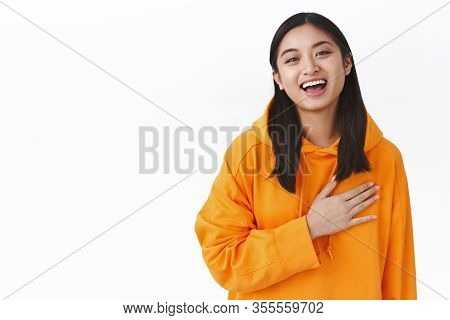 Close-up Portrait Humble Cute Asian Girl Being Praised, Receive Heartwarming Compliments, Hold Hand