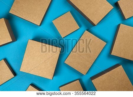 Brown Cardboard Boxes On Blue Background, Top View