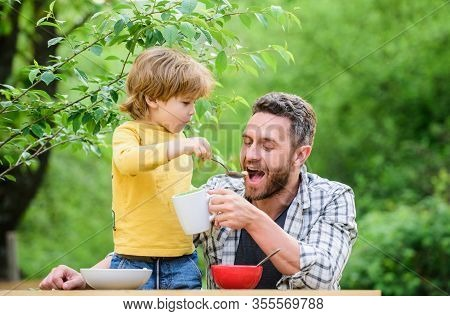 Menu For Children. Family Enjoy Homemade Meal. Food Habits. Little Boy With Dad Eating Food Nature B