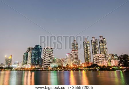 Cityscape Image Of Benjakitti Park At Sunset Time With Reflection In Bangkok, Thailand, Cityscape Im