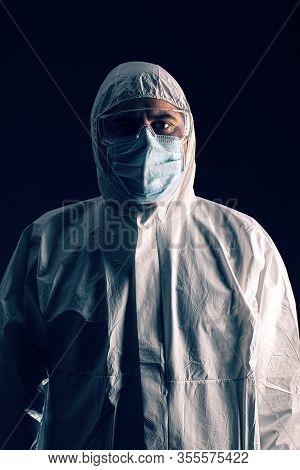 Medical Scientist Wearing Protective Clothing, Mask And Glassware