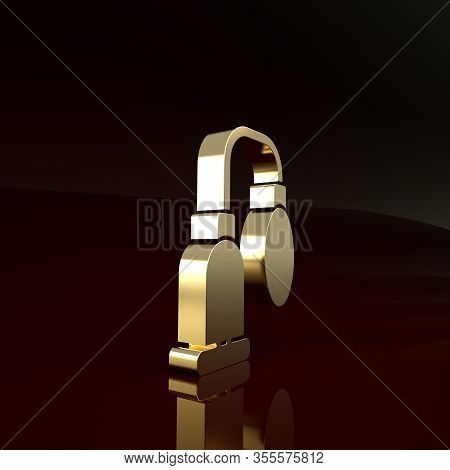 Gold Penis Pump Icon Isolated On Brown Background. Penis Enlarger. Sex Toy For Men. Vacuum Pump With