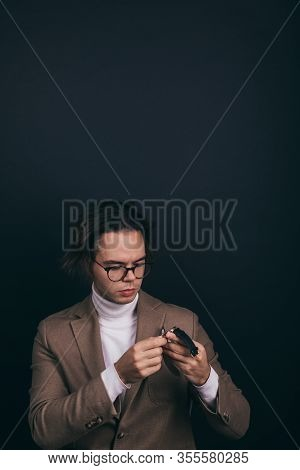 A Dapper Young Man Obviously You Wearing A White Turtleneck Sweater And A Beige Jacket With Handkerc