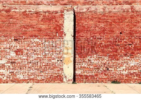 Bright Sunlit Vintage Red Brick Building Wall
