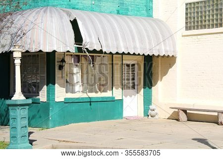 Abandoned Green Store Building Awnings Glass Brick Window Shadows