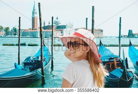View On Grand Canal With Woman Traveler In Hat On Academia Bridge In Venice. Back View
